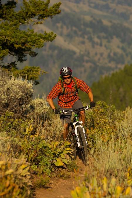 A male and female enjoy mountain biking on Snow King mountain, Jackson, WY.